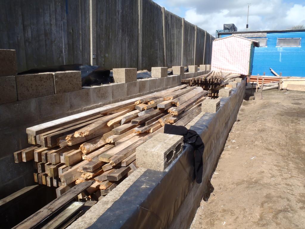 Timber-stacked-on-lane-1