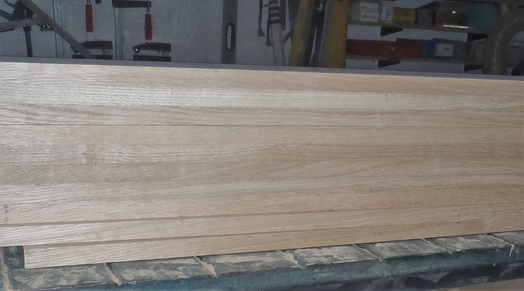 Newest-pile-of-planed-20mm-Oak-1