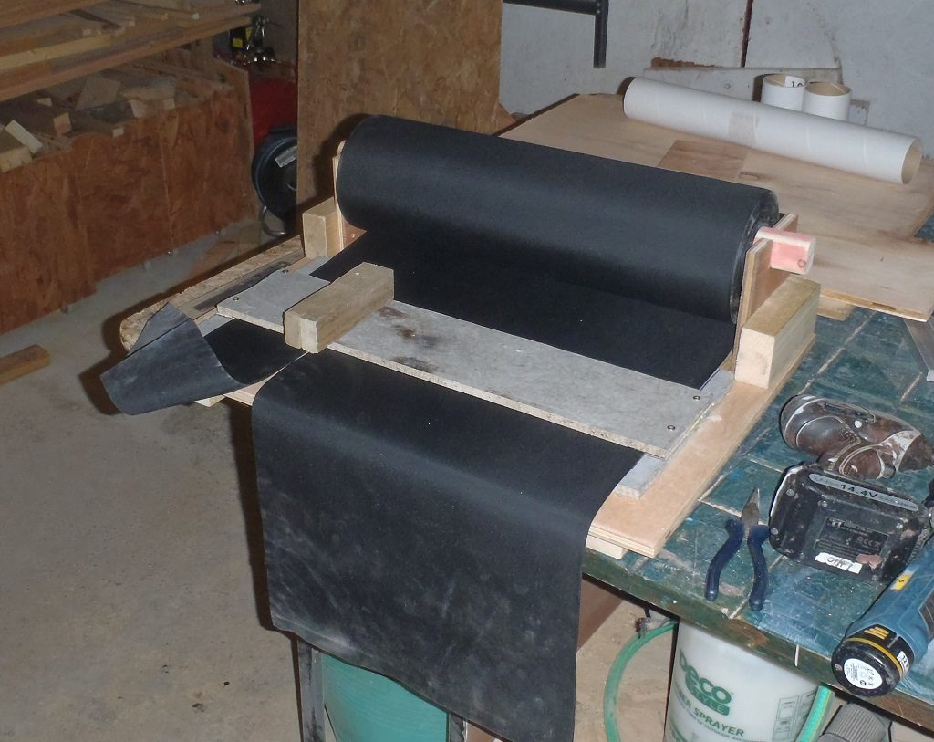 Dispenser and Cutter for Rolls of Rubber membrane