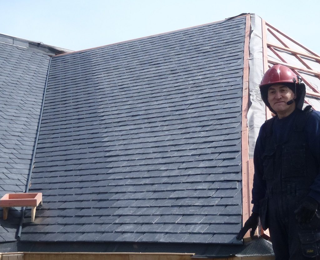 Section J Fully Covered in Slates, K All Battened Up and Guttering Complete Along Back of Building