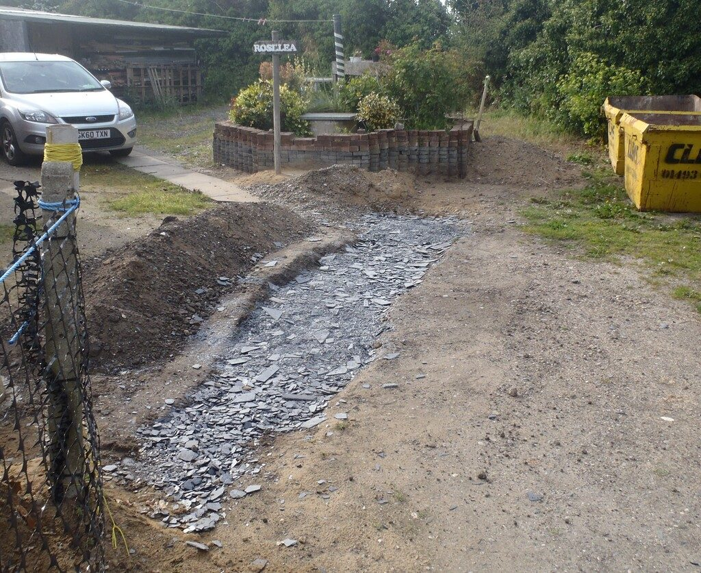 Driveway-Berm-All-the-scrap-slates-smashed-up-in-the-trench