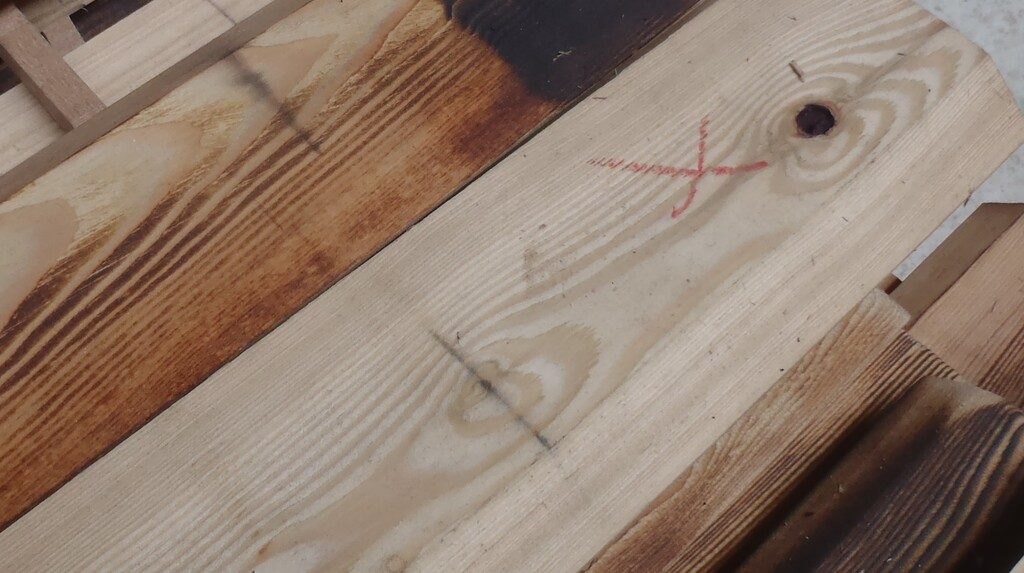 Black-Iron-marks-on-the-timber
