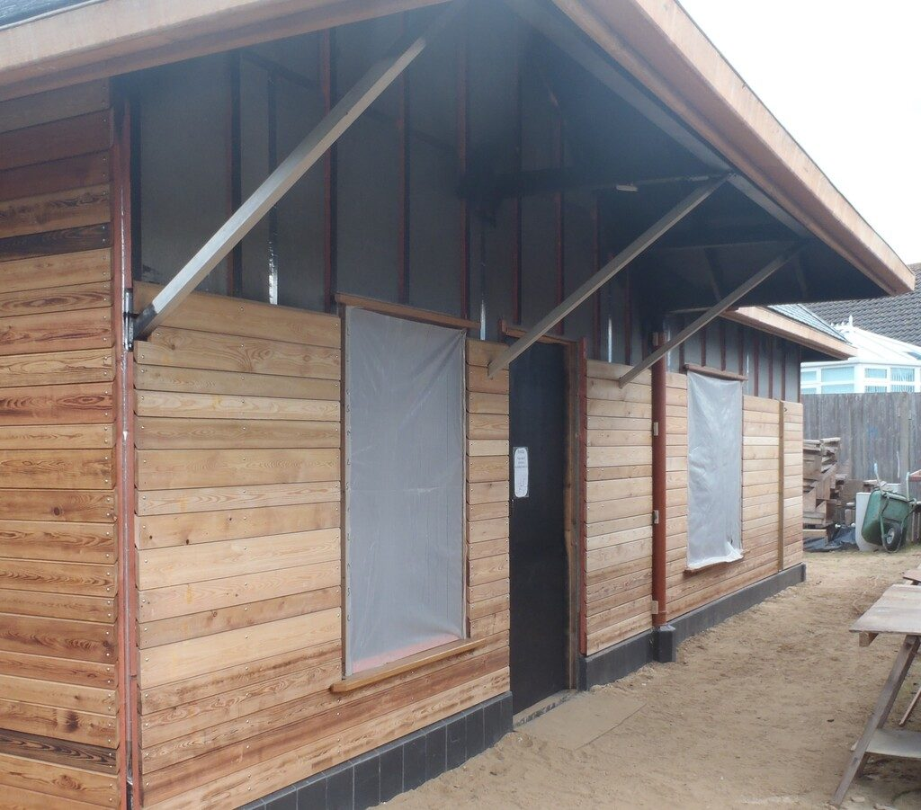 Cladding Second Stage - The Fire Treated Larch Timber for the Back of the House