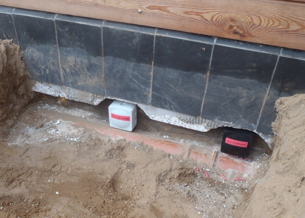 Installed Dozens of Conduits and Pipes through the External Wall for Future Expansion