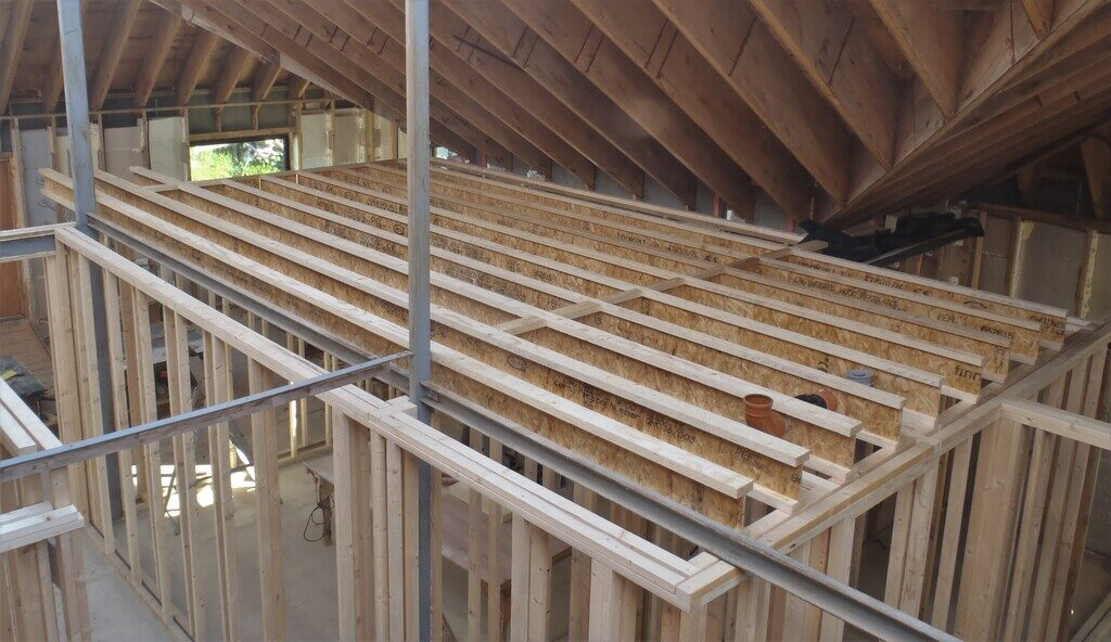 Started Installing Joists for First Floor