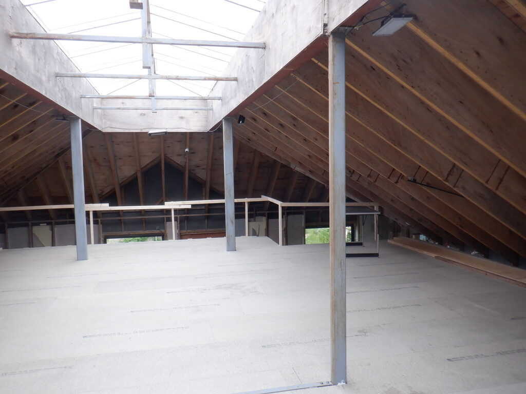 Work Continues on Construction of First Floor and Its Floorboards
