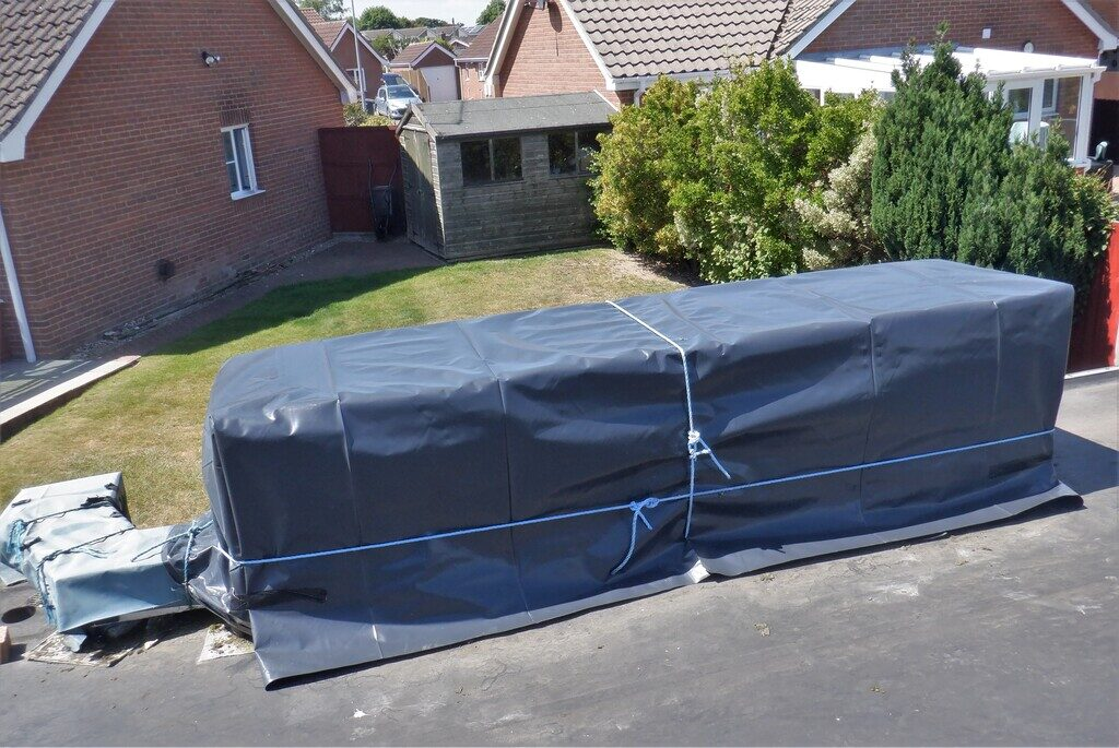 Sun Shield Patched and Installed over our Corridor plus New Waterproof Cover for Header Tank